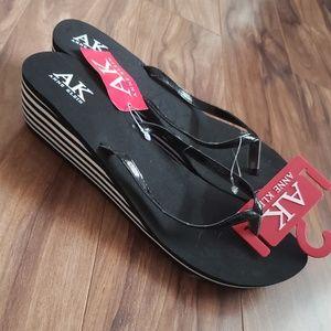 Anna Klein wedge sandal. Black and white stripes